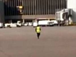 Cleaner facing sack after sprinting across Manchester Airport taxiway